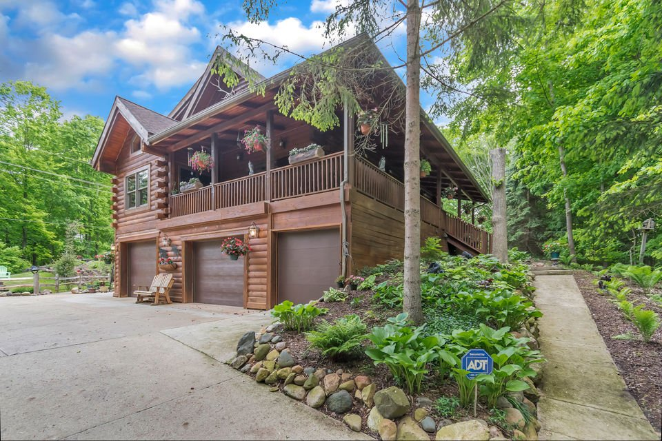 This log cabin home has pool with retractable roof for $475K