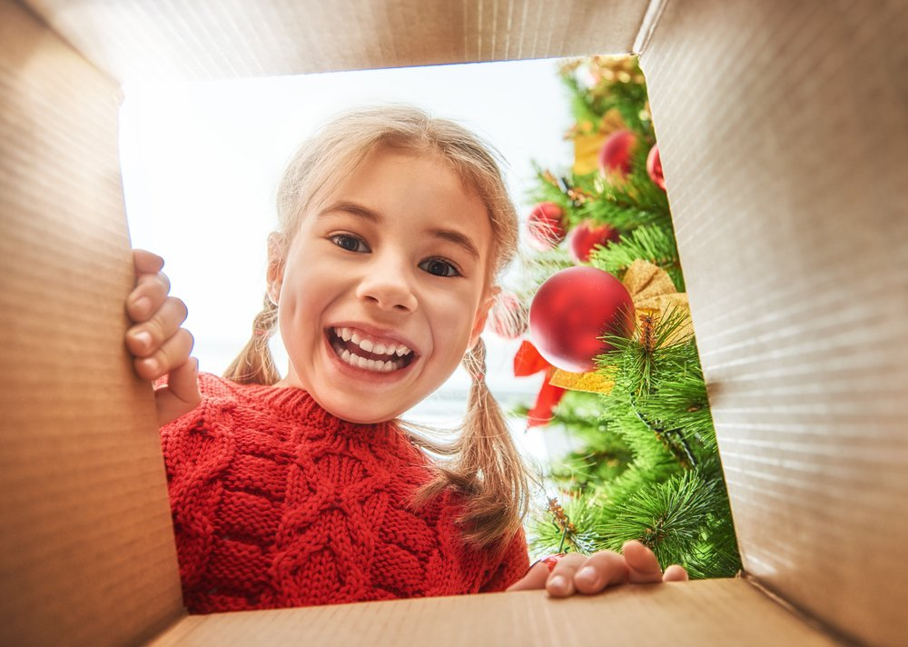 Child looking into present box