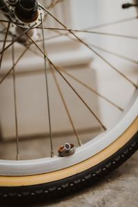 Wedding rings on bicycle wheel