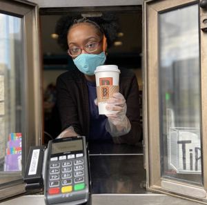 Masked Biggby barista working drive thru