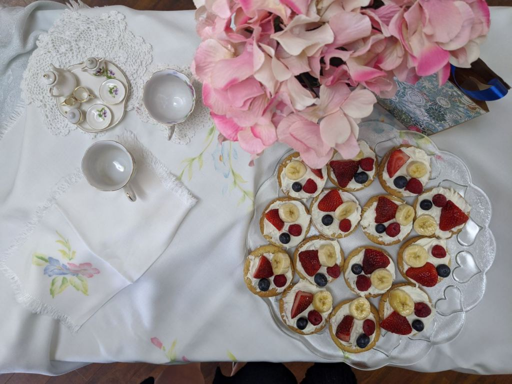 During a Mother's Day Tea at MediLodge at the Shore in Grand Haven, each resident mom was treated to a plate of sugar cookies topped with cream cheese icing and fresh fruit, along with strawberry lemonade and a homemade purse filled with tissues, hard candy and chocolates.
