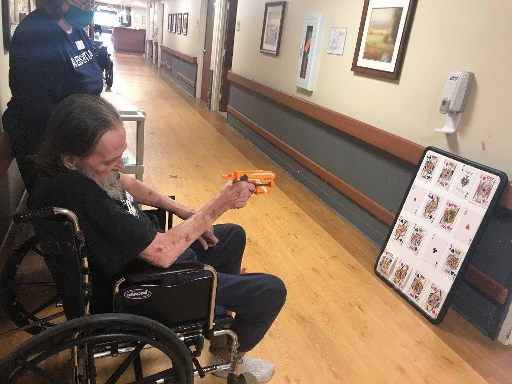 In addition to a wheelchair decorating contest, residents at MediLodge of Clare have fished for rubber duckies and tried their aim in a hallway Nerf gun shooting contest.