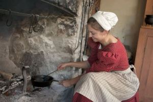 Historical interpreter at the fireplace