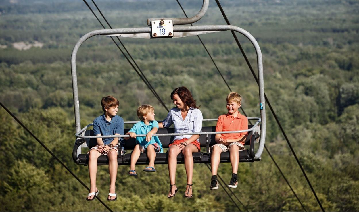 family rides a chairlift in Benzie County