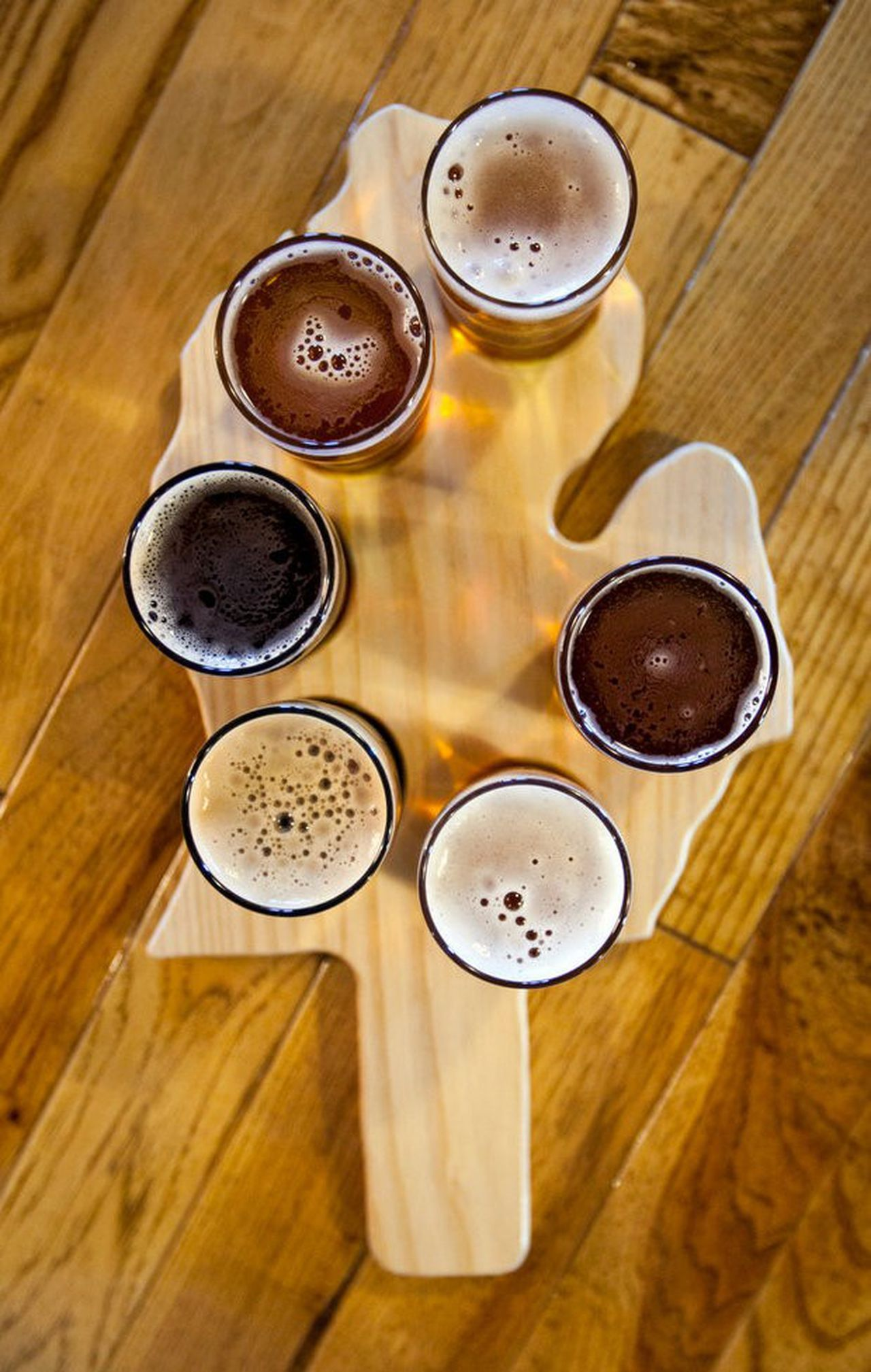 Glasses of beer on a state of Michigan shaped board