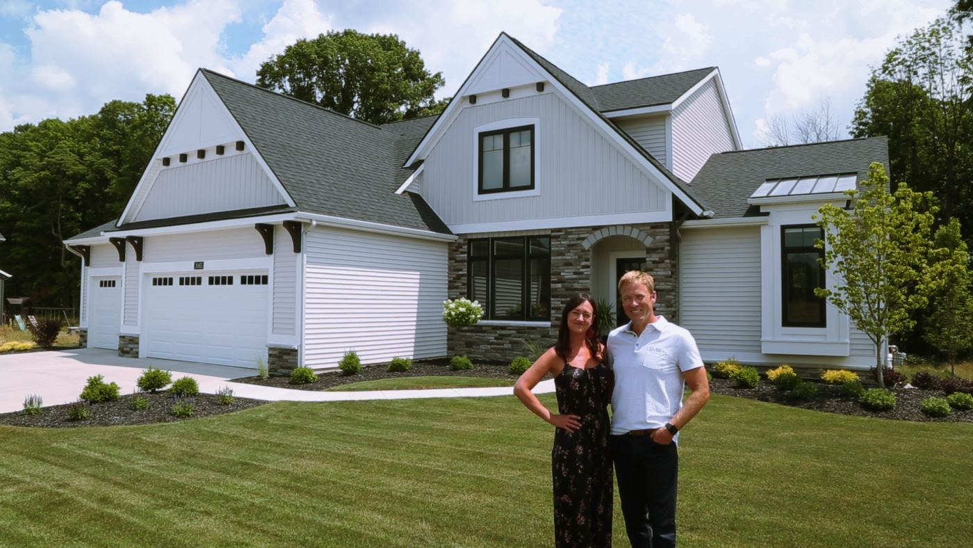 Candie and Dustin Sentz in front of their Eastbrook Homes built home