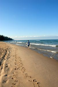 Walking along a beach in Mackinaw area