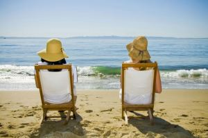 Couple in chairs on the beach