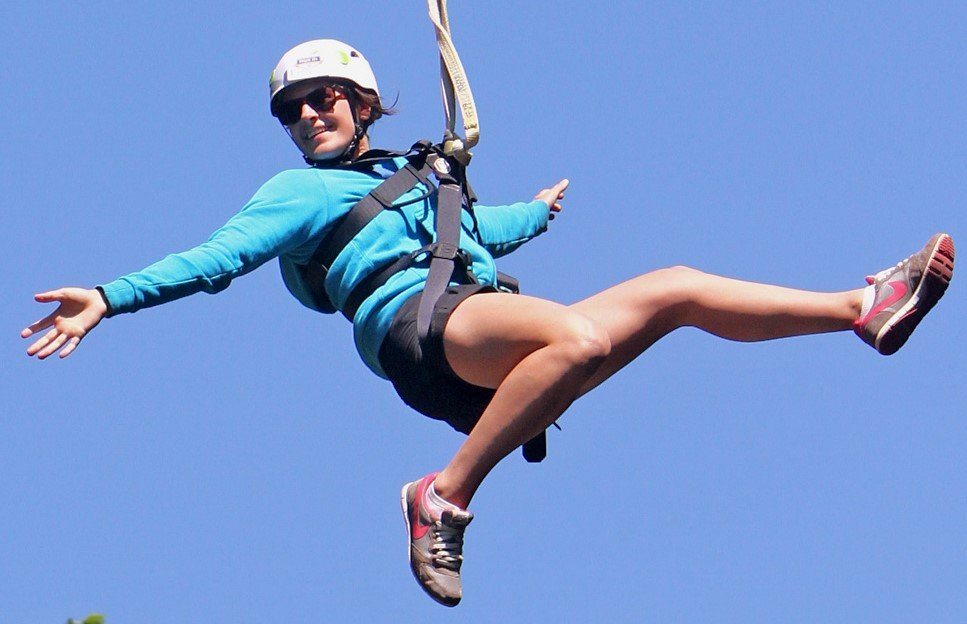 Woman zip lining in Petoskey, MI