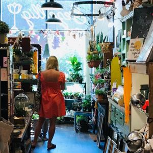 woman shopping in a knick knack store