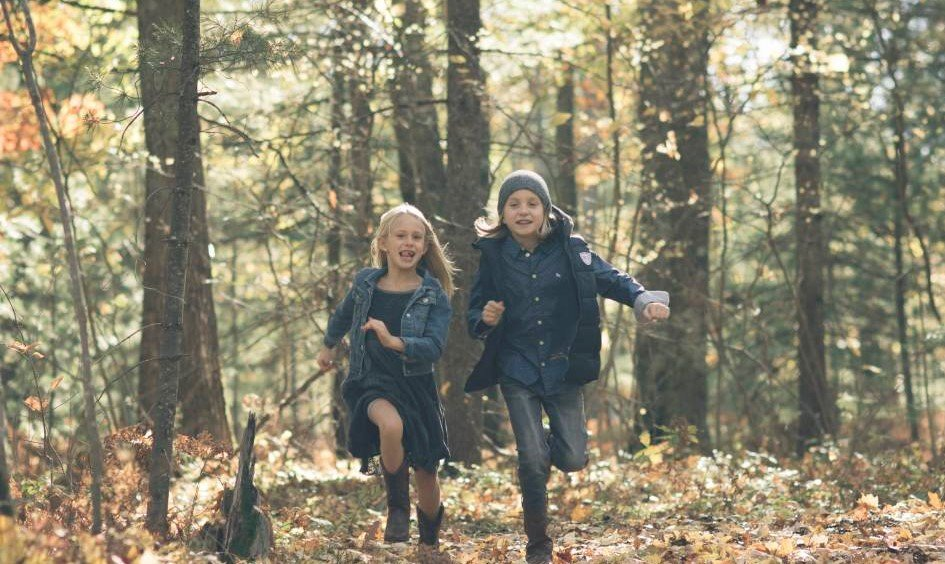 kids running in the woods