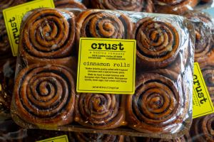 Package of cinnamon rolls from Crust, a baking company