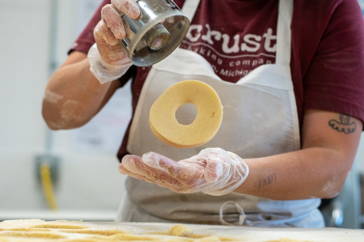 Crust, a baking company, baker making doughnuts
