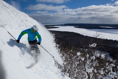 person downhill skiing in Michigan